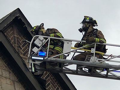 McKinney Fire Department on a ladder