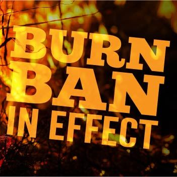 Fire with text that says Burn Ban in Effect