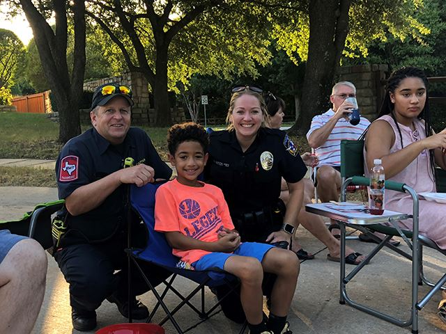 National Night Out - Fire and Police personnel with young boy