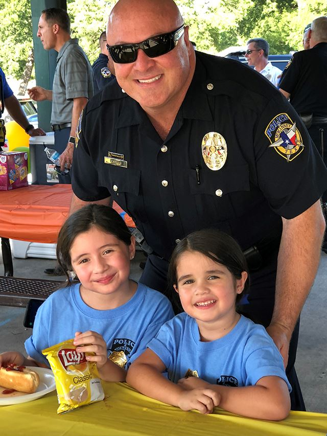 National Night Out - officer with smiling children