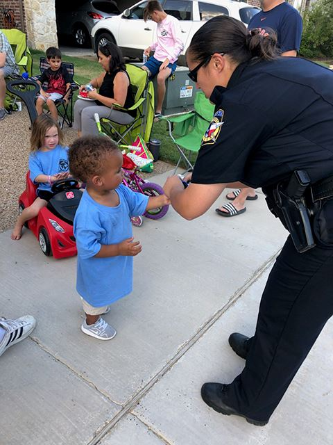 National Night Out - tiny boy with female Police Officer