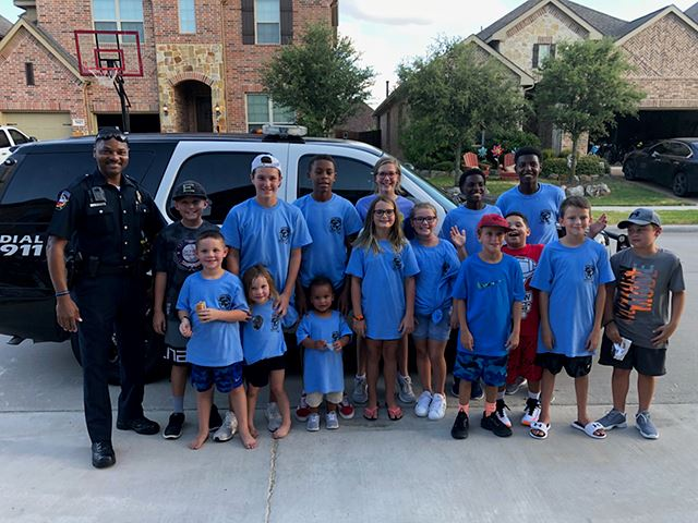 National Night Out - officer with children and police car