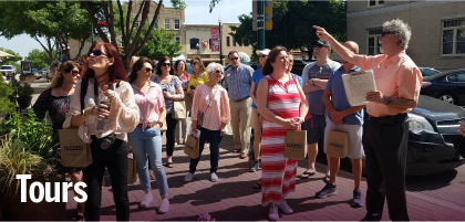 Group of people on a tour - Link to Walking Tours page