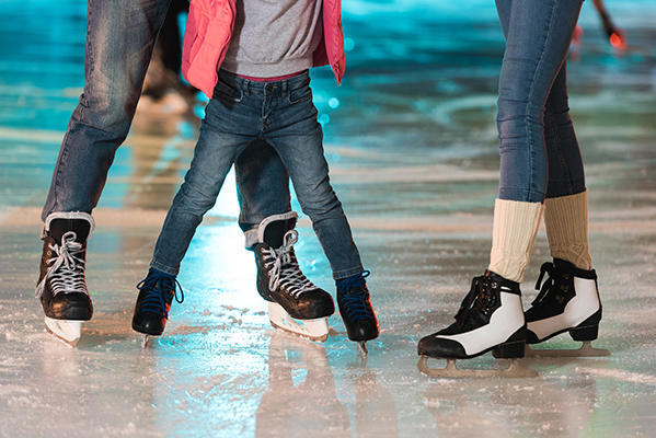 Family wearing ice skates at ice rink