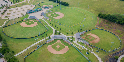 Aerial view of four baseball fields and one little league field