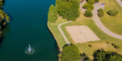Areal view of lake with fountain and volleyball courts on shore
