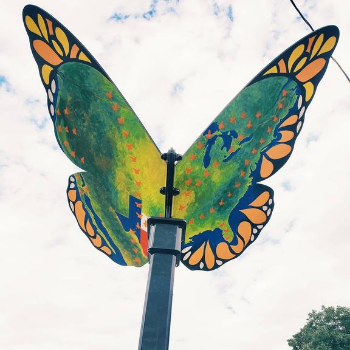Butterfly sculpture with migration paths of butterflies painted on wings