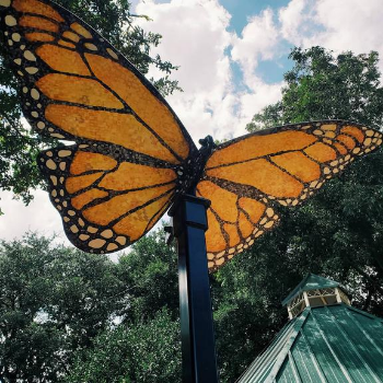 Butterfly sculpture with wings painted to resemble a monarch butterfly