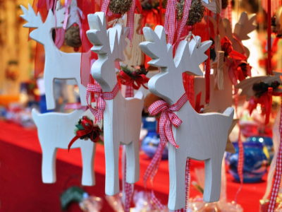 Reindeer ornaments hanging from ribbons